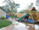 Wonderful playset in inviting backyard